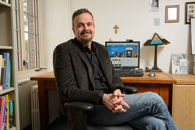 Bradley Wright, associate professor of sociology, oversees a new project that is gathering real-time data on Americans' spirituality. (Peter Morenus/UConn Photo)