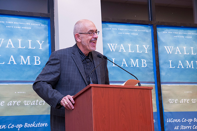 Wally Lamb shares excerpts from his new book We are Water, during the book launch at the UConn Co-op Storrs Center bookstore on Oct. 21, 2013. (Juanita Austin '15 (CLAS)/UConn Photo)