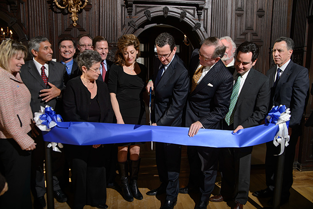Governor Dannel P. Malloy, center, cuts a ceremonial ribbon at an event to announce the launch of the Institute for Community Resiliency and Climate Adaptation held on Jan. 24, 2014 at the Branford House at the University of Connecticut Avery Point campus in Groton. (Peter Morenus/UConn Photo)