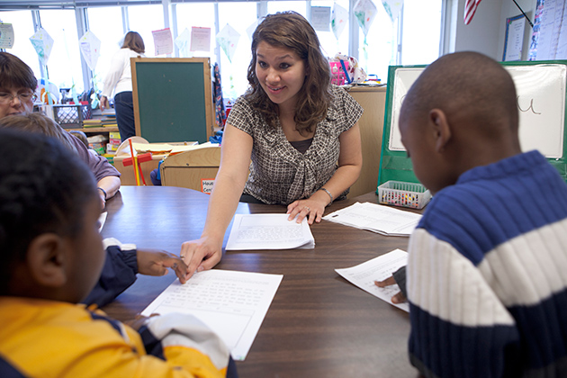 Nicole LaPierre works with students in a classroom during her student teaching practice.