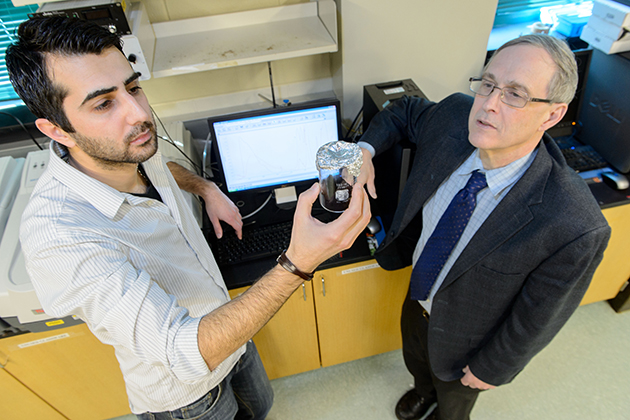 Altug Poyraz, eft, a graduate student, with Steven Suib, distinguished professor and director of chemistry on Jan. 9, 2014. (Peter Morenus/UConn Photo)