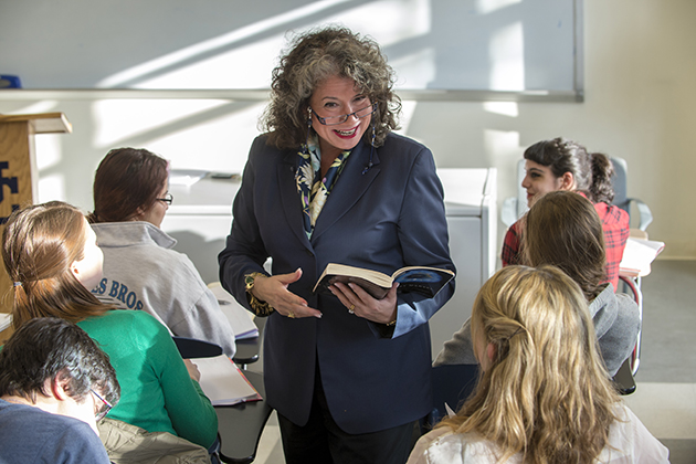 Regina Barreca, professor of English, leads a class at the Austin Building. A recent report shows UConn provides an affordable, high-quality education for students, regardless of their economic means.