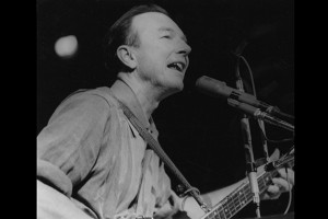 Pete Seeger performs at a 1965 peace rally in New York City. (Photo by Diana Davies, courtesy of Smithsonian Folkways)