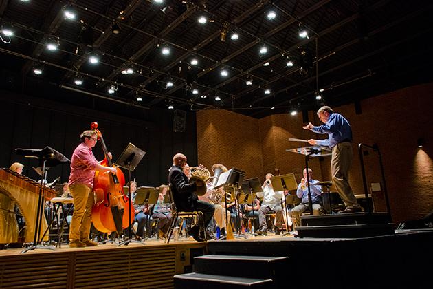 Members of the UConn Wind Ensemble rehearse Kevin Walczyk's 2012 Sackler Award-winning original composition in the von der Mehden Recital Hall. (Ariel Dowski '14 (CLAS)/UConn Photo)