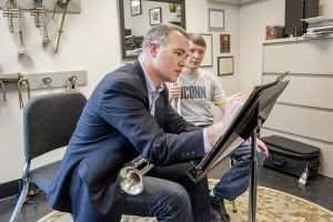 Louis Hanzlik, music professor and trumpet player gives one-on-one instruction to Sean Sonntag '18 at the department of music on March 27, 2014. (Sean Flynn/UConn Photo)