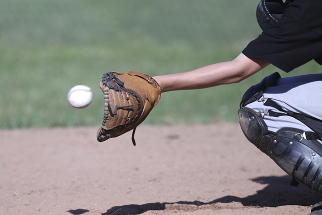 Baseball flying into a waiting catcher's mitt. Focus on mitt; ball slightly blurred to show speed and motion.(istock photo)