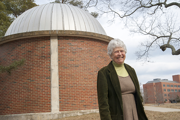 Cynthia Peterson, professor of physics, outside the Planetarium on North Eagleville Road. The facility, constructed in 1954, was the first planetarium in Connecticut. (Sean Flynn/UConn Photo)