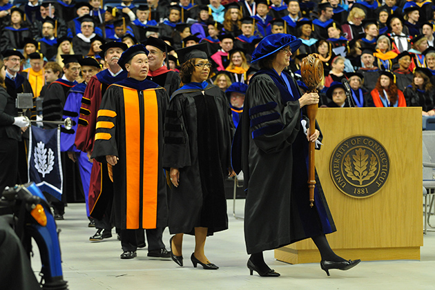 Sally Reis, Board of Trustees Distinguished Professor of Educational Psychology, bears the mace at the head of the Academic Procession, at the start of a UConn commencement ceremony. (UConn File Photo)