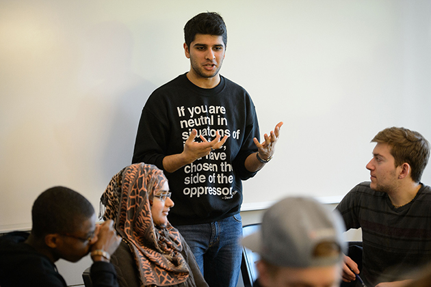 Varun Khattar '16 (CLAS) discusses with students safe ways to respond to a situation of violence during a workshop on bystander intervention. (Peter Morenus/UConn Photo)