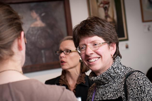 UConn professor of art and art history Cora Lynn Deibler, a longtime member of the Society of Illustrators, speaks with alumni. (Elzbieta Kaciuba for UConn)