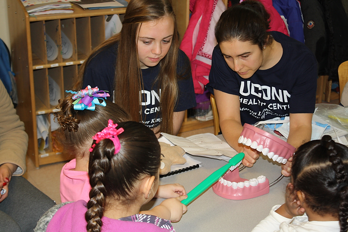 UST scholars work with children at ÒBrushing BunnyÓ program events in an effort to improve their oral health. (Photos provided by Petra Clark-Dufner)