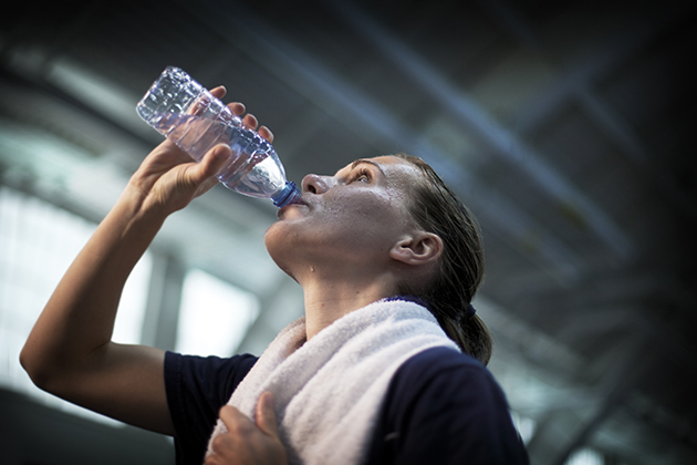 An athlete rehydrates after a training session. (UConn Photo)