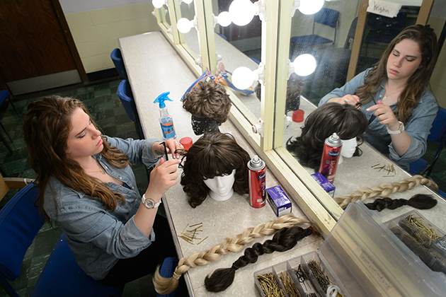 Bailey Rosenberg '14 (SFA) styles a wig backstage at the Harriet S. Jorgensen Theatre on May 22, 2014. (Peter Morenus/UConn Photo)