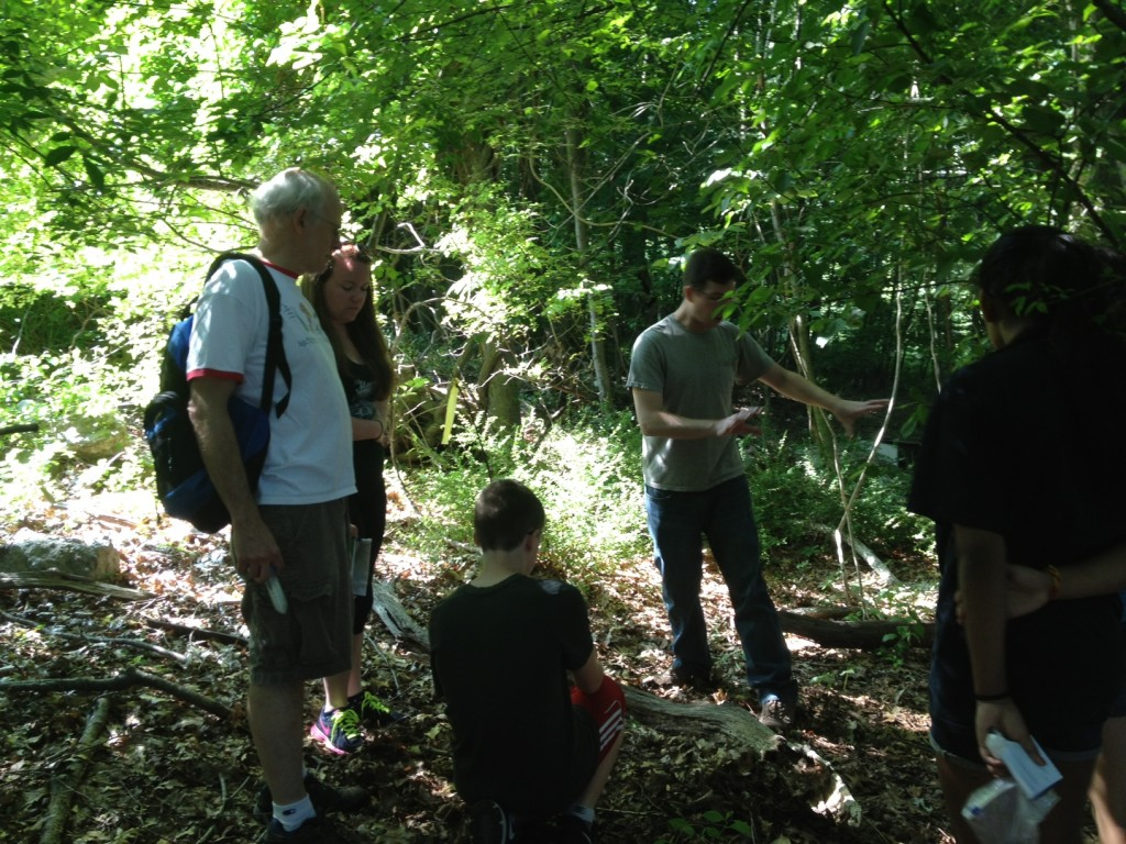 Dr. Kenneth Noll with microbiology Ph.D. students Jamie Micciulla and Charles Bridges, lead KASET participants on a search for termites on the UConn campus. Termites are full of microbes that enable them to break down wood and produce energy. (David Colberg/UConn Photo)