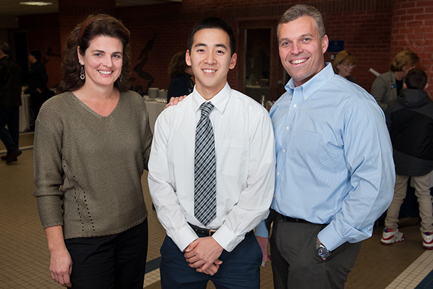 From left, Tina Stietzel '90 (BUS), Michael Byon '15 (ENG), and Chuck Stietzel '91 (ENG), '93 MS at the UConn Alumni Association Donor and Scholarship Recognition reception last December. (The Defining Photo, for UConn)