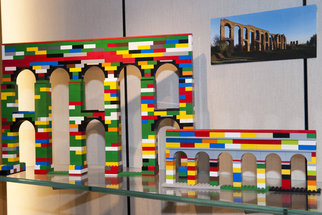 A Lego model of tThe Aqua Claudia, built between 38 AD and 52 AD and considered to be one of the finest of all Roman aqueducts. A photo of the aqueduct is shown for comparison. (Sean Flynn/UConn Photo)
