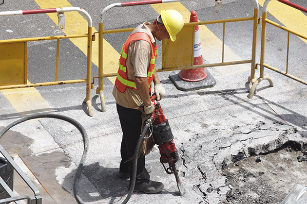 A worker using a jackhammer for road repairs is vulnerable to hearing loss, one of the most common types of occupational illness. (iStock Photo)