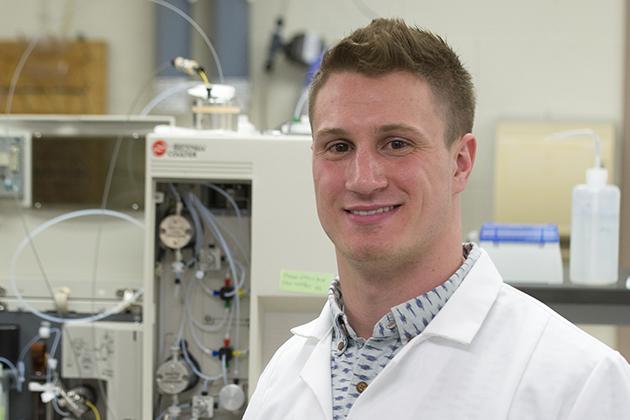 JJ Bivona '16 (CLAS) in the lab on April 16, 2015. (Peter Morenus/UConn Photo)