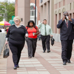 Overweight people walking down a city street. (Photo courtesy of the Rudd Center)