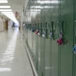 A row of lockers in an empty school hallway. (iStock Photo)
