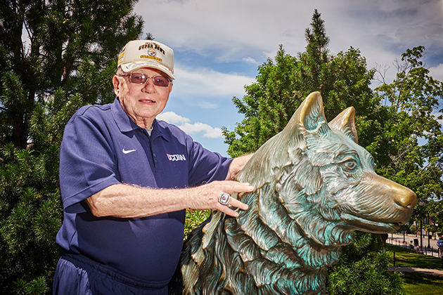 Harry Hartley, president emeritus, with the Jonathan statue on July 16, 2015. (Peter Morenus/UConn Photo)