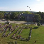 Members of the Class of 2019 assemble on the Great Lawn for a class photo. (Elizabeth Caron/UConn Photo)