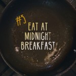 A frying pan with the words #5 Eat at Midnight Breakfast for December's #UConnBucketList.