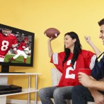 Fans watching a football game on TV. (iStock Photo)