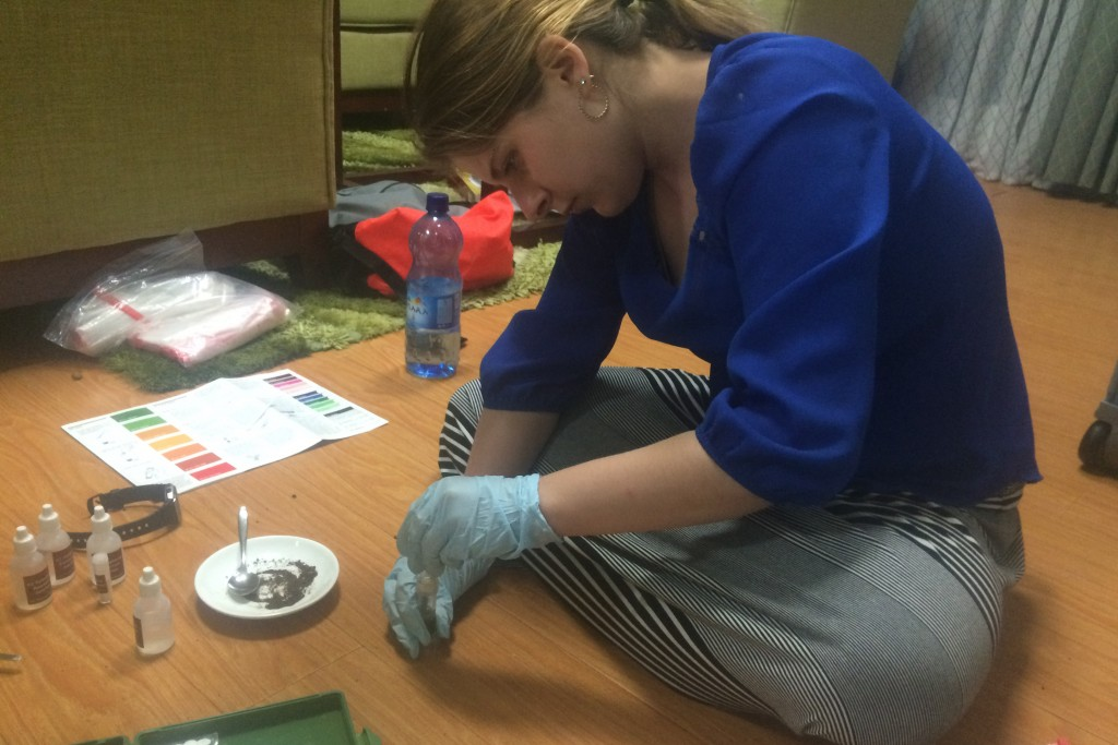 Kelsey Reeves '16 (ENG) tests soil samples for nutrients in her hotel room.