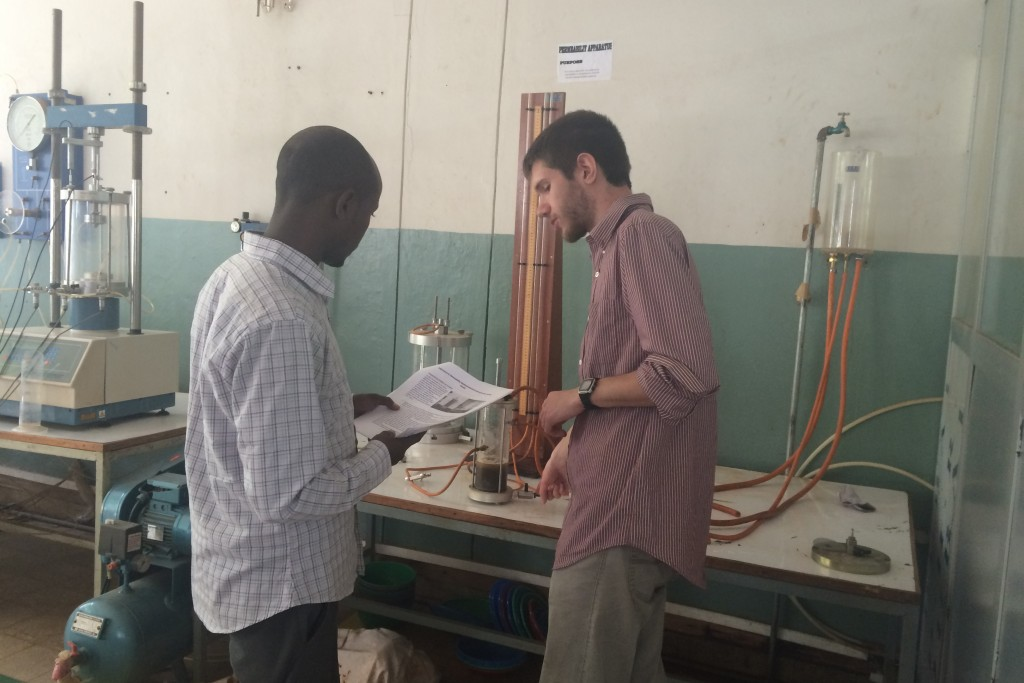 Mamo Kassegn Sisay, left, a researcher with the Ethiopian Institute of Water Resources, and Ryan Cordier '18 (ENG) measure the permeability of the soil. The cylinders behind them measure how fast water travels through soil.