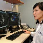 Reading echocardiography images is one way Dr. Agnes Kim monitors cancer survivors' risk for heart disease as part of UConn Health's Cardio-Oncology Program. (Tina Encarnacion/UConn Health Photo)