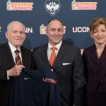 David Benedict, center, is introduced as the new Athletic Director by Board of Trustees Chairman Larry McHugh and University President Susan Herbst, at a press conference held at the Burton Family Football Complex today. (Peter Morenus/UConn Photo)