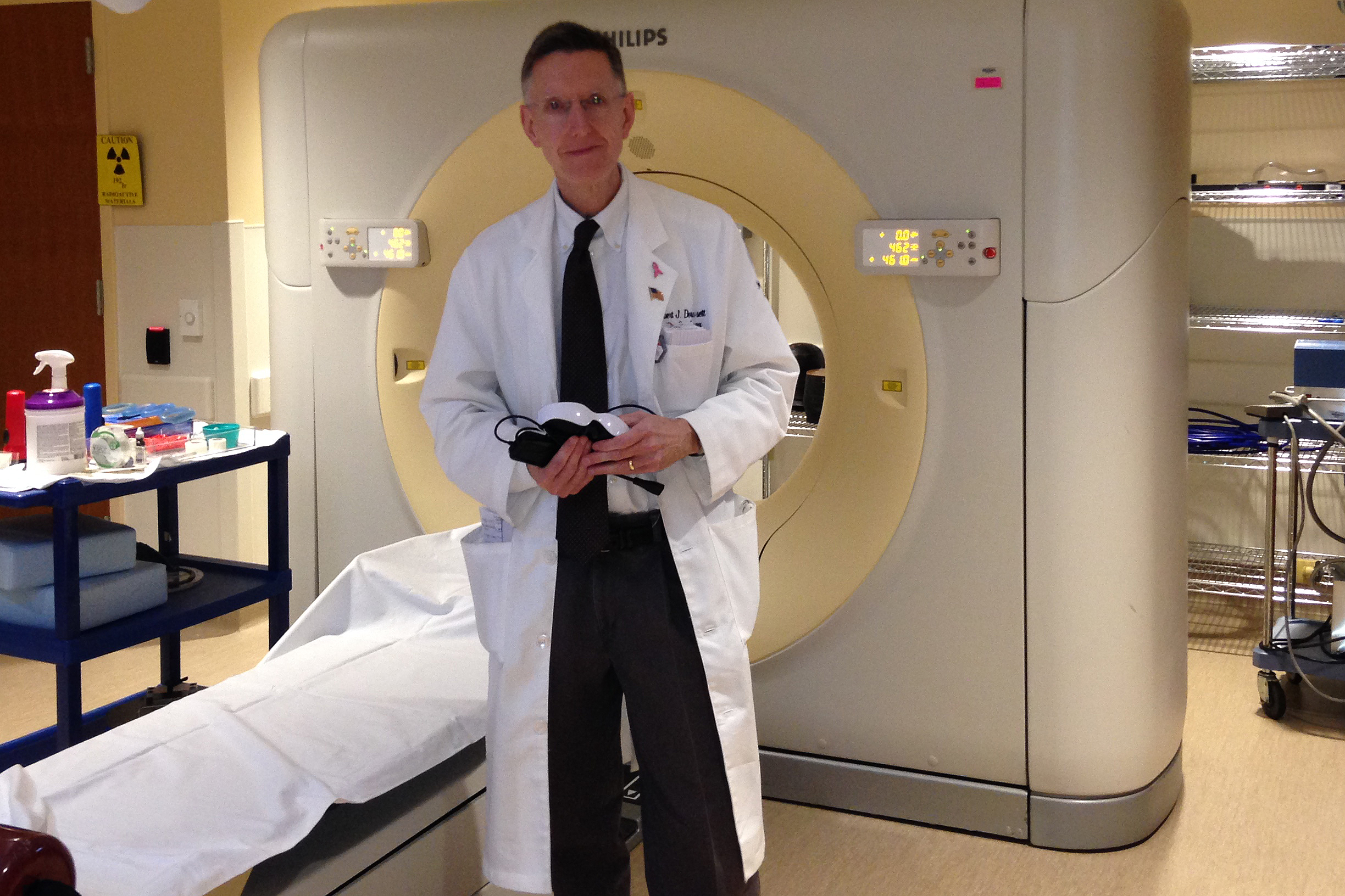 Radiation oncologist Dr. Dowsett with CT Scan technology in the Radiation Planning (simulation) Room at the Carole and Ray Neag Comprehensive Cancer Center at UConn Health. (Lauren Woods/UConn Health Photo)