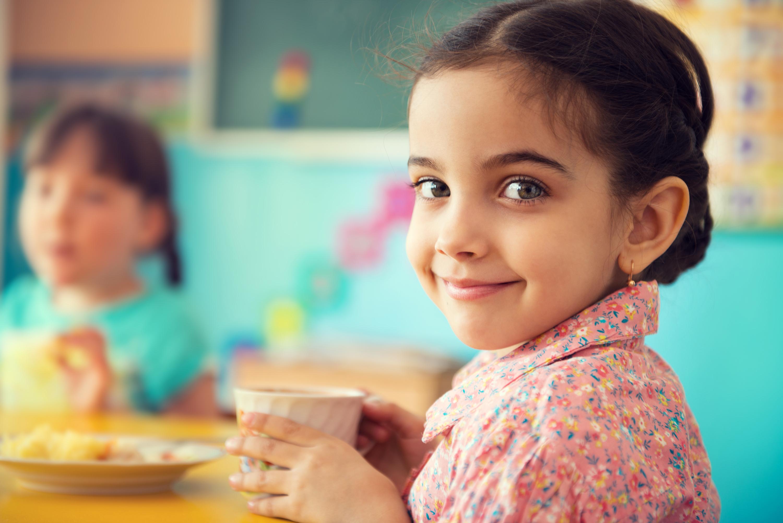 Children eating breakfast at school. (Shutterstock Photo)