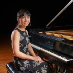Calliope Wong poses for a portrait at the piano onstage at von der Mehden Recital Hall on Sept. 30, 2015. (Peter Morenus/UConn Photo)