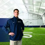 Head football coach Bob Diaco in the Schenkman Football Facility. A gift from Diaco and his wife Julia will help fund new facilities for other sports at UConn. (Stephen Slade '89 (SFA) for UConn)