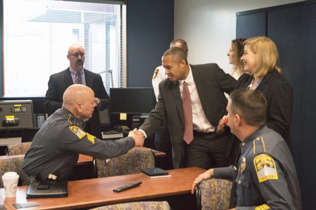 Alumnus Robert Hotaling '01 (ENG) meets with members of the UConn Police
