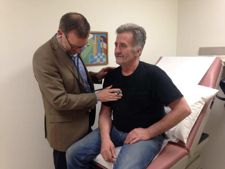 Cardiac arrest survivor Richard Couture with his longtime Electrophysiologist Dr. Christopher Pickett at UConn Health on April 29 during his first check-up a few weeks after UConn Health Cardiologist Dr. Manny Katsetos saved his life with bystander CPR.