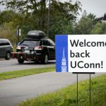 A sign outside the Storrs Congregational Church welcomes students back to campus on Aug. 26, 2016. (Peter Morenus/UConn Photo)