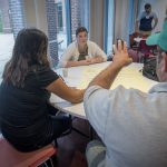 Attendees at the 2016 Intellectual Humility in Secondary Education Summer Institute discuss their beliefs on what causes genocide at the Thomas J. Dodd Research Center on Aug. 1, 2016. (Sean Flynn/UConn Photo)