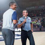 Men's basketball head coach Kevin Ollie, let, and women's basketball head coach Geno Auriemma share a joke during First Night 2015. (Stephen Slade '89 (SFA) for UConn)