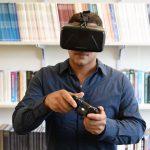John Christenson wearing a virtual reality headset. (UConn Photo)