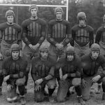 Nine players from the Connecticut Agricultural College football team, known as the 'Aggies,' in 1927.