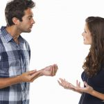 Couple engaged in a heated discussion. (momentimages/Getty Images)