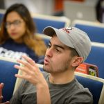 Michael Correia '19 (CLAS) discusses election polling in Professor Charles Venator-Santiago's political science class on Nov. 4, 2016. (Peter Morenus/UConn Photo)