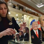 An employee displays traditional Russian wooden nesting dolls depicting US President-elect Donald Trump, Russian President Vladimir Putin at a gift shop in central Moscow just days ahead of Trump's inauguration. ( Alexander Nemenov/AFP/Getty Images)
