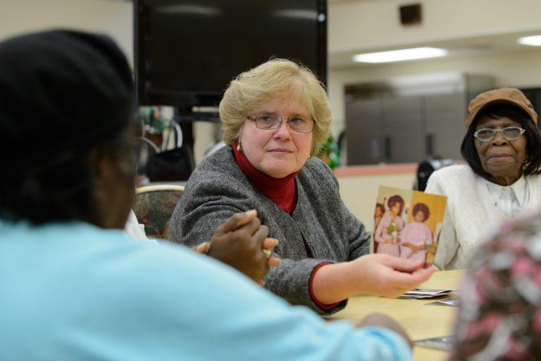 Juliette Shellman, associate professor of nursing, speaks with seniors at the North End Senior Center in Hartford. (Peter Morenus/UConn File Photo)