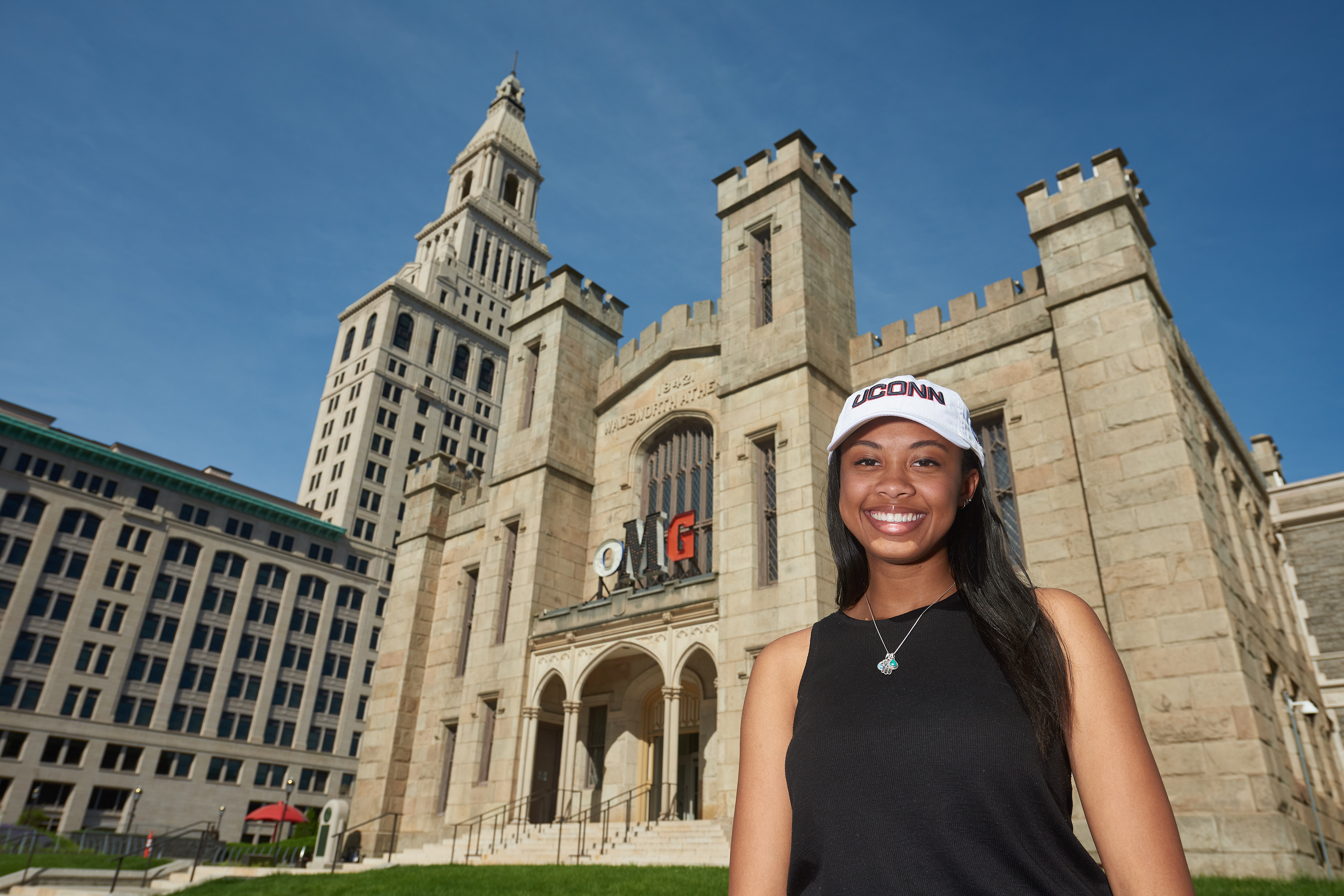 A student stands outside the Wadsworth Atheneum in Hartford. (Peter Morenus/UConn Photo)