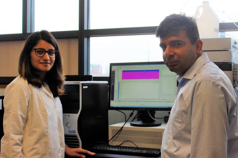Graduate student Shipra Malik and Raman Bahal in the lab.