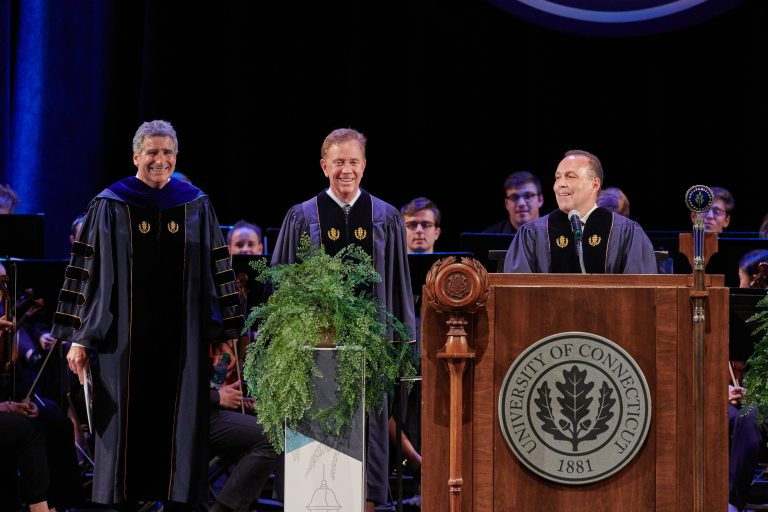 President Thomas Katsouleas, left, Gov Ned Lamont and Dan Toscano '85 (BUS), chair of the board of trustees, during the inauguration ceremony held at the Jorgensen Center for the Performing Arts on Oct. 4, 2019. (Peter Morenus/UConn Photo)